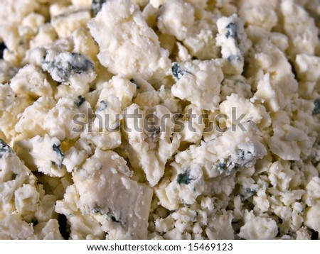 Crumbled Gorgonzola cheese on a serving plate - stock photo