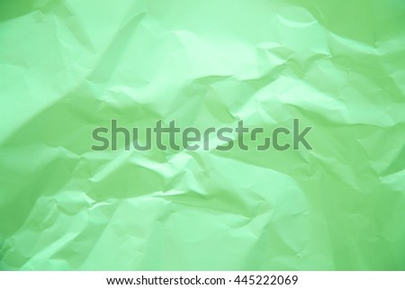 Crumbled papers background texture with light green color - stock photo