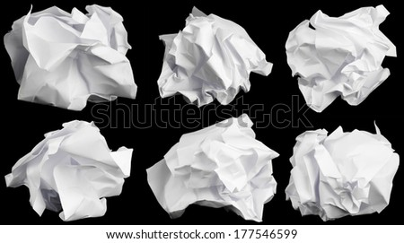 Crumbled up paper isolated on black background.