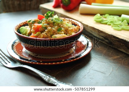 Crumbly pearl barley with vegetables and grilled chicken, healthy, diet tasty summer dish
