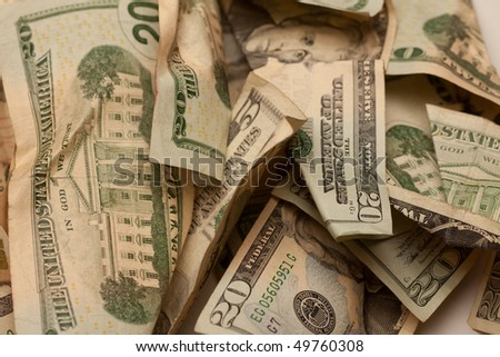 Crumpled american dollar bills isolated on white - stock photo