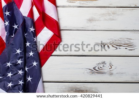 Crumpled American flag. American flag on wooden background. Banner laying on white table. Democracy and freedom. - stock photo