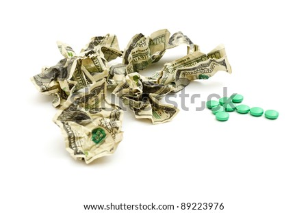 Crumpled american money and pills isolated on white