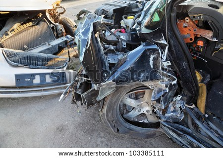 Crumpled and broken hoods of two collided cars after accident - stock photo
