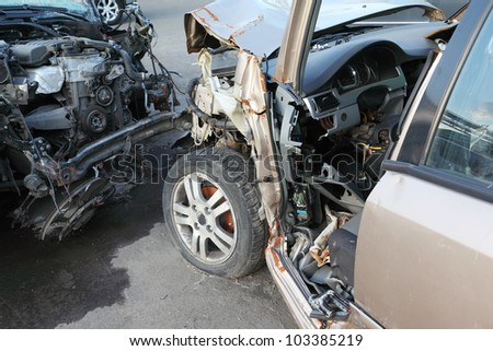Crumpled and broken hoods of two collided cars after terrible accident - stock photo