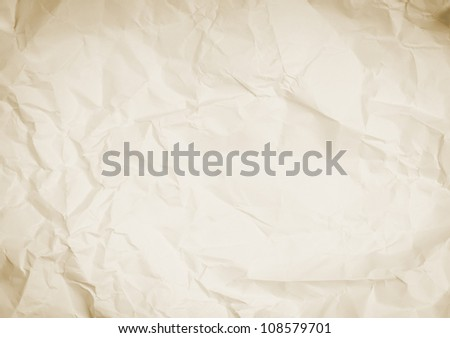 Crumpled and wrinkled sepia paper background texture - stock photo