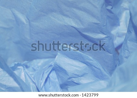 Crumpled blue tissue paper for a background or gift wrap for husband, father, boyfriend, son, or brother. - stock photo