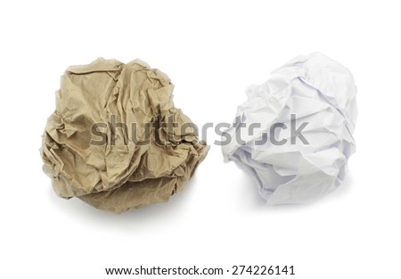 Crumpled brown and white paper on white background.