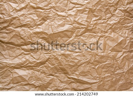 Crumpled Brown Packing Paper Backgrond. - stock photo