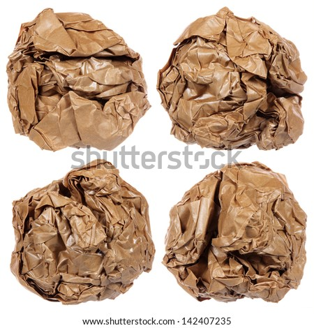 Crumpled brown paper ball isolated on white background - stock photo