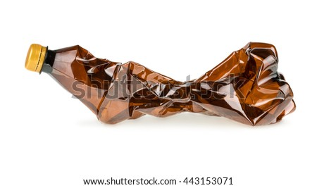 Crumpled brown plastic bottle isolated on white background - stock photo