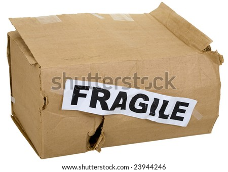 "Crumpled cardboard box with inscription ""fragile"" on white"