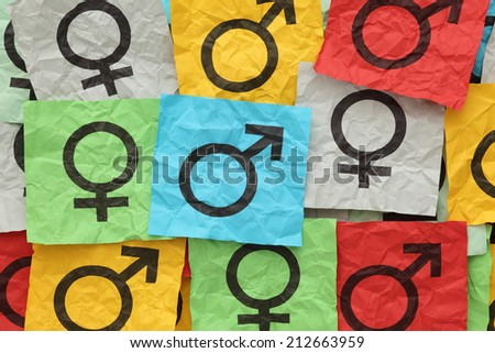 Crumpled colorful paper notes with gender symbols. - stock photo