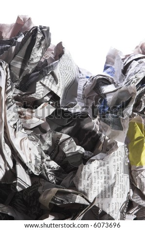 Crumpled discarded newspapers isolated on a white background. - stock photo