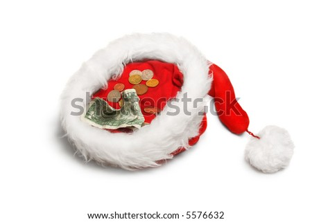 Crumpled 1 dollar banknote and small coins in Santa hat