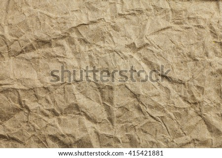 Crumpled eco paper textured background.