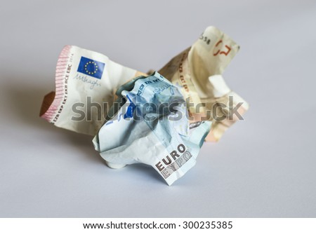 Crumpled Euro banknotes representing political and economic threats that European Union has to face and, more generally, economic difficulties, inflation and waist of money.  - stock photo