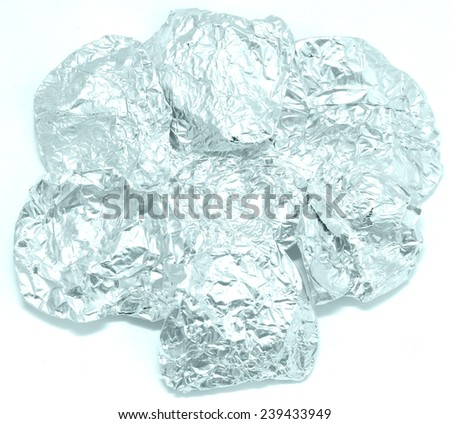 crumpled foil on a white background - stock photo