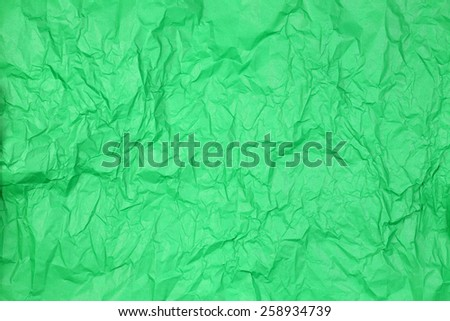 Crumpled green paper texture for background - stock photo
