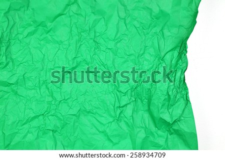 Crumpled green paper texture for background with white space - stock photo