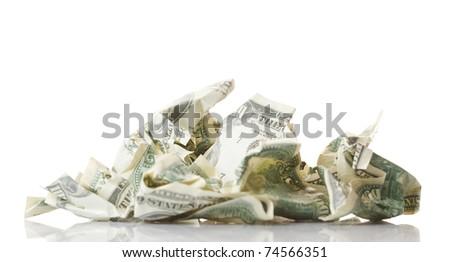 Crumpled money. Isolated over white. - stock photo