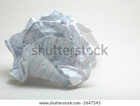 Crumpled note paper, foolscap, with writing on it, on white. - stock photo