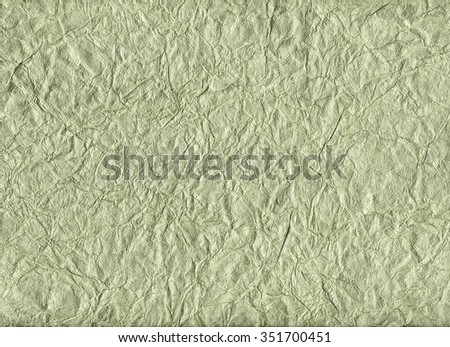 Crumpled pale green velvet paper for backgrounds - stock photo