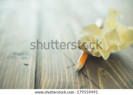 Crumpled paper and pencil macro - stock photo