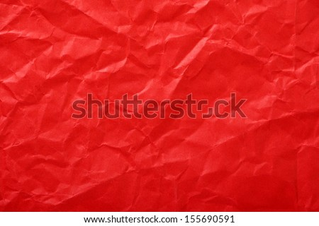 Crumpled paper background made from a blood red sheet of wrapping paper. - stock photo