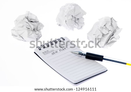 Crumpled paper ball and notepad