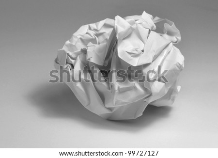 crumpled paper ball in light grey back