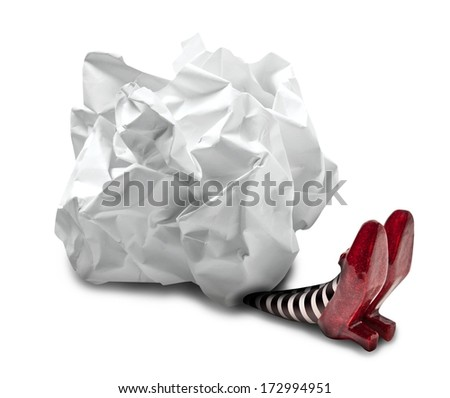 Crumpled paper fallen on wicked witch - stock photo