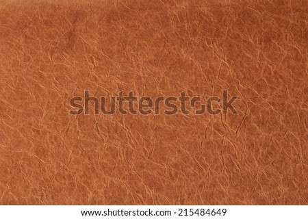 crumpled paper faux leather orange structure, universal overlay surface - stock photo