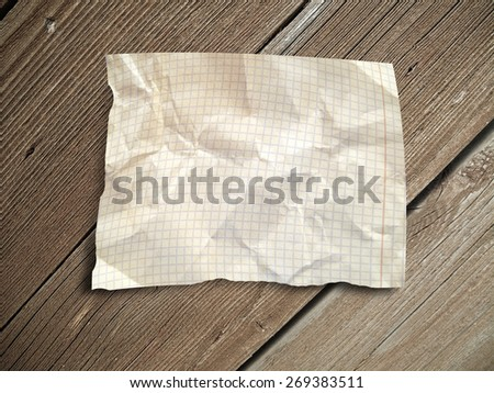 Crumpled paper for text on wood background - stock photo