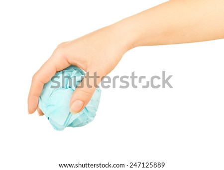 crumpled paper in a female hand on a white
