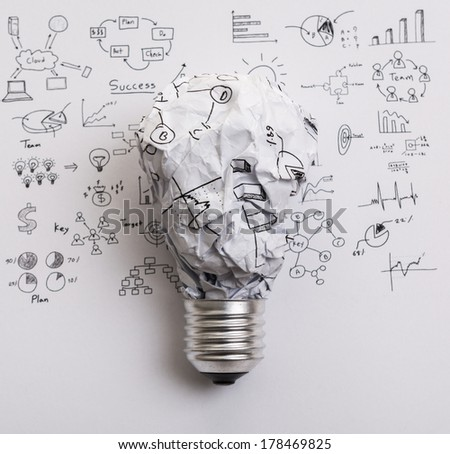 Crumpled paper Light bulb with drawing graph - stock photo