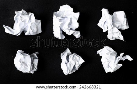 Crumpled paper on a black background - stock photo