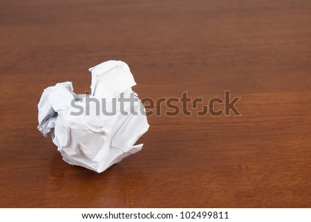 crumpled paper on table closeup - stock photo