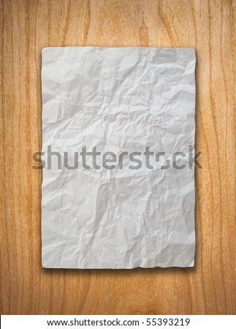 Crumpled paper on wood wall
