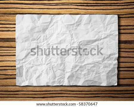 crumpled paper on zebrano Wood background horizontal