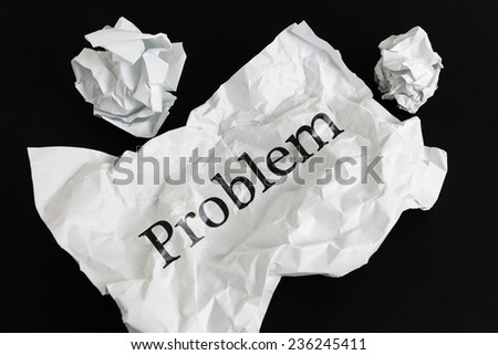 Crumpled paper sheet with word Problem isolated on black - stock photo