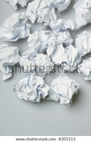 Crumpled paper wads on the floor - copy space below - stock photo