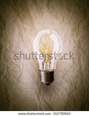 Crumpled paper with a lightbulb idea concept - stock photo