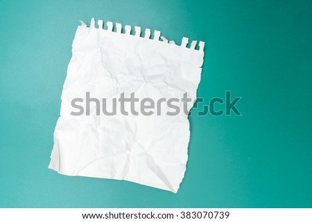 Crumpled paper with green background - stock photo