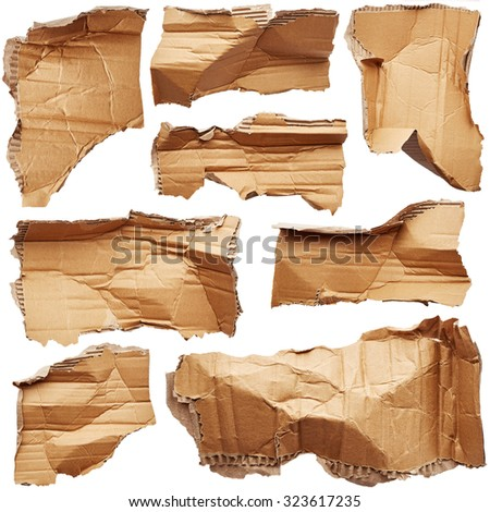 Crumpled pieces of cardboard isolated on white background - stock photo