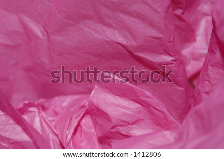 Crumpled pink tissue paper for a background or gift wrap for wife, mother, girlfriend, daughter, or sister.