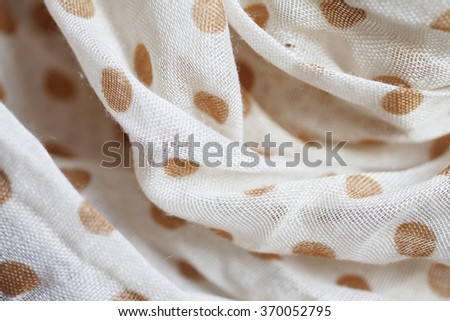 Crumpled polka dot fabric texture