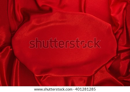 Crumpled red velvet with flattened oval section as the background - stock photo
