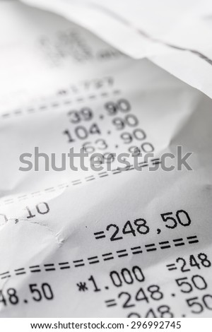 crumpled sales receipt close up on the table - stock photo