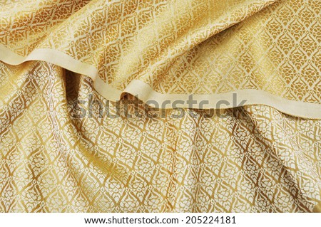 crumpled thai silk fabric textured background - stock photo